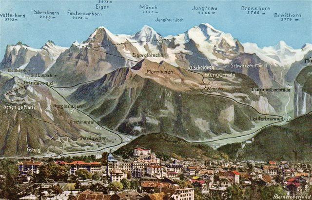 Postkort afsendt fra Interlaken 1906. Man ser BOB med to linjer, WAB og Jungfraubahn, der her som planlagt fører helt til toppen af Jungfrau. Den stoppede dog midtvej mellem Jungfrau og Mönch i lavningen der, kaldet et pas eller et Joch. Også banen til Mürren ses. Bemærk vandfaldet nedenfor. Også banen til Schynige Platte ses. Wilderswil (her Wilderwyl) og Gsteig er byttet om?